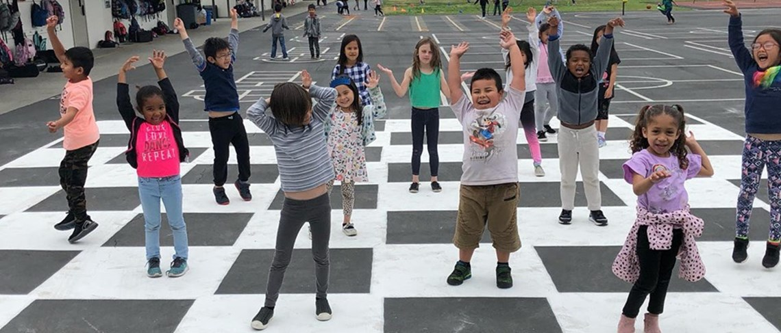 Students enjoying their new life size checker and chess board. Yahoo!