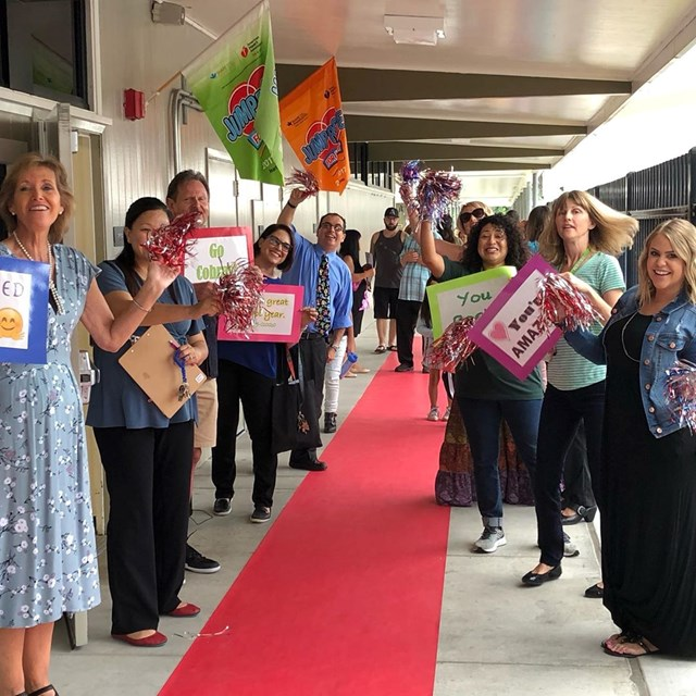 Teachers and staff giving students a red carpet welcome back on their first day