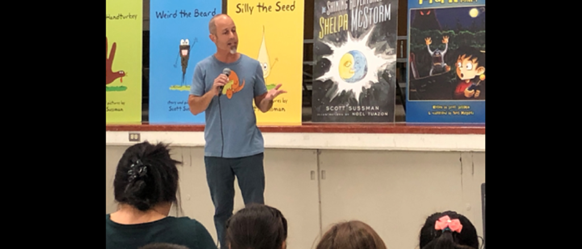Famous children's author, Scott Sussman, discussing the joys of writing in front of students.